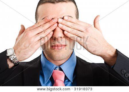 Man shutting his eyes