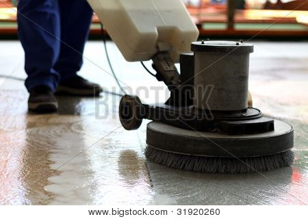 Cleaning machine washing the floor