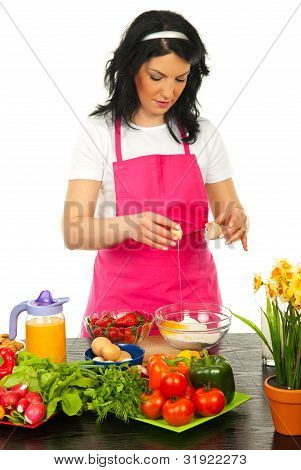 Woman Put Egg In Flour