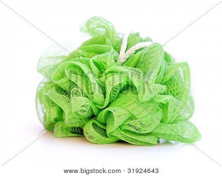 Green nylon bath washcloth on white background