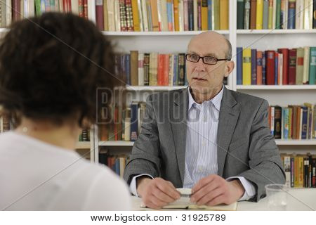 woman talking to a consultant, lawyer or advisor
