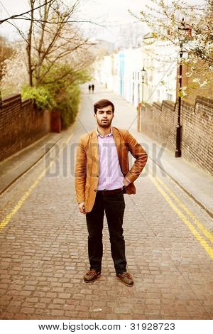 Pakistani man in London Mews.