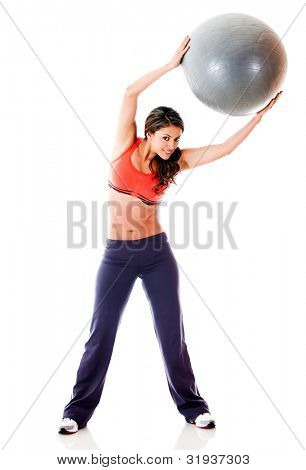 Woman doing pilates with a Swiss ball - isolated over a white background