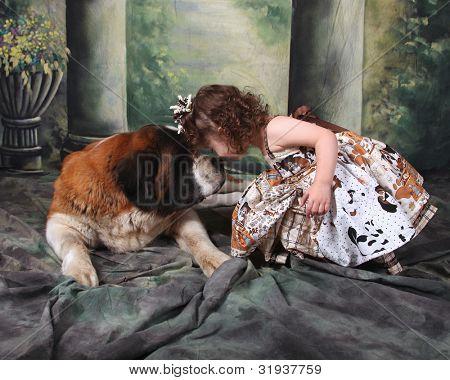 Child and Her Saint Bernard Puppy Dog