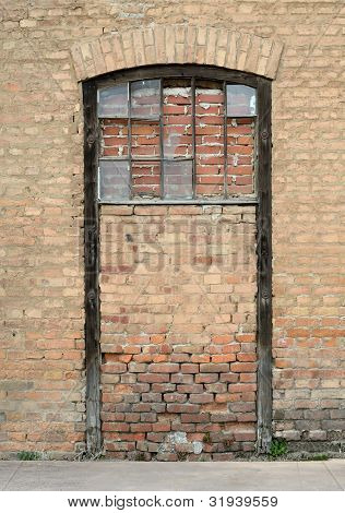 sealed door with brick wall