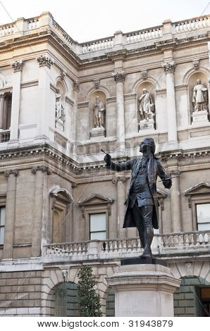 LONDON, UK - JANUARY 13: Statue of Sir Joshua Reynolds in the atrium of the Royal Academy of Arts. January 13, 2012 in London. Burlington House has been the home of the Royal Academy since 1867.
