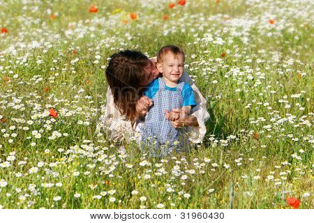 mother and child in flower field