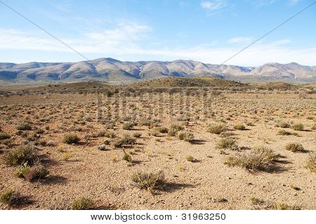 Semi-desert Region With Mountains And Blue Sky