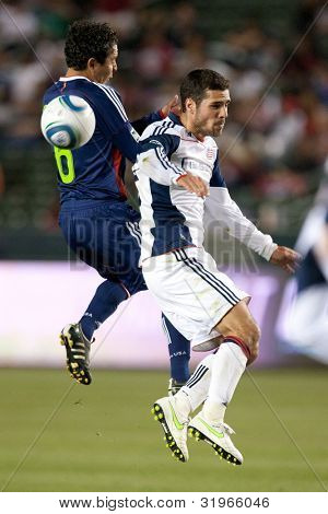 CARSON, CA. - APRIL 30: Chivas USA midfielder Francisco Mendoza #6 (L) & New England Revolution midfielder Benny Feilhaber #22 during the MLS game on April 30 2011 at the Home Depot Center.