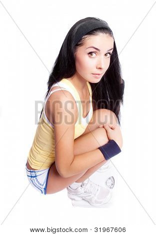 beautiful young woman using floor scales for measuring her weight, isolated against white background