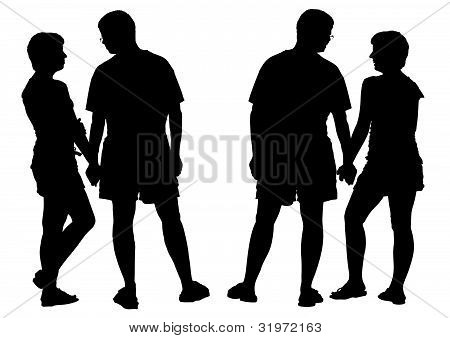 Two silhouettes of young romantic pair