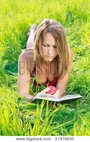 Beautiful Woman Reading Book With Apple In Hand
