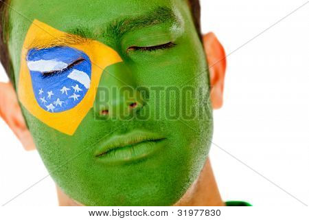 Man with Brazil flag painted on his face - isolated over  white backgorund
