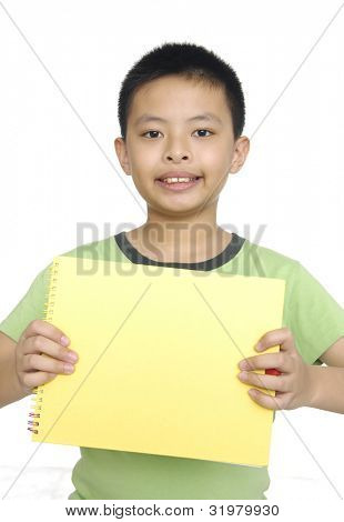 Nice child with blank notebook isolated on white background