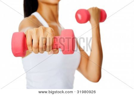 Anonymous hispanic woman do toning exercises with weights in studio isolated on white