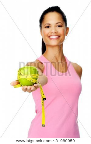 Healthy happy hispanic woman with apple and tape measure for diet and weight loss concept