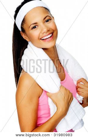 Nice friendly smile portrait of a healthy fit hispanic woman with gym towel isolated on white