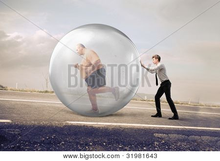 Businessman pushing a bubble with fat man running in it