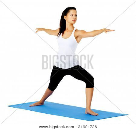 Young yoga woman warrior pose. This is part of a series of various yoga poses by this model, isolated on white