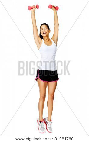 Healthy active hispanic woman raises dumbbell weights above her head for toning exercises