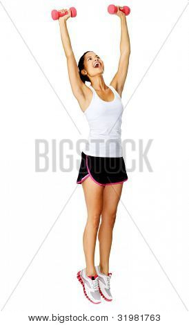 Healthy active hispanic woman raises weights above her head for toning exercises