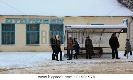 People Waiting For A Bus On A Bus Stop. Gagarin (former Gzhatsk). Russia.