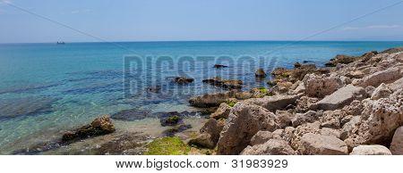 sunny rocky beach of Mediterranean Sea
