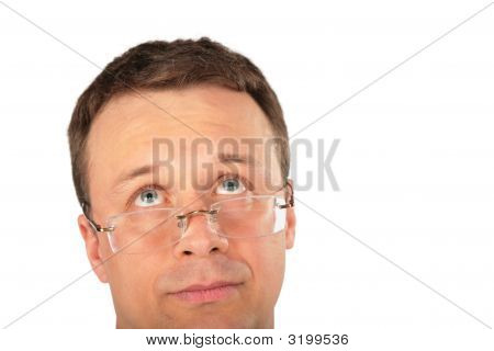 Head Of Pensive Man In Glasses Look Up