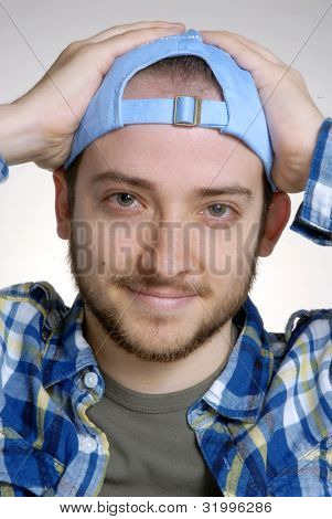 Expressive and happy young man portrait.Young man using a hat.