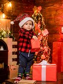 Open Gift. Lovely Baby Enjoy Christmas. Santa Boy Little Child Celebrate Christmas At Home. Childhoo poster