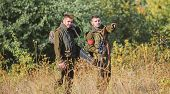 Illegal Hunting. Hunters Friends Enjoy Leisure. Hunters With Rifles In Nature Environment. Poacher P poster