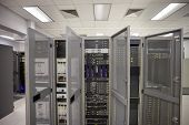 a data Centre in a satellite room with all the convertors of signals, frequencies and server room poster