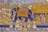 foto of courtier  - Colorful indian mural in the fort at Jodhpur showing a royal procession including elephant and courtiers from the Rajput era
