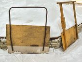 Two Scrapers For Snow Removal. Wooden Shovels For Cleaning The Street. Snow Scraper On A Sunny Day. poster