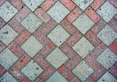 Red And Gray Road Tiles On City Street Pavement With Growing Moss In Mortar. Road Construction Backg poster