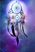 foto of american indian  - a magic dreamcatcher over cosmic background with stars and a planet - JPG