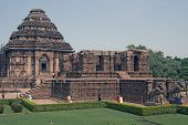 image of surya  - Ancient Hindu Temple at Konark Orissa India. 13th Century AD. Large stone building set in landscaped gardens