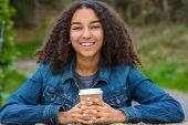 Beautiful happy biracial mixed race African American girl teenager female young woman smiling with p poster