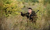 Bearded Serious Hunter Spend Leisure Hunting. Man Wear Camouflage Clothes Nature Background. Hunting poster