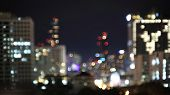 City Skyline Light At Night. Blur Bokeh Defocus Bangkok City Skyline Night Light. Buildings Light In poster