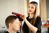 Hairdresser Combing Male Hair And Blowing By Dryer. Young Hairstylist Drying Man Haircut. Woman Beau poster