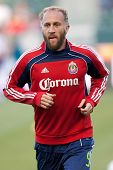 CARSON, CA. - APRIL 30: Chivas USA midfielder Simon Elliott #9 during the MLS game on April 30 2011