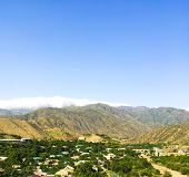Clear Sky Over A Village In The Caucasus, In The Mountains Of Dagestan. The Village And Mountains Of poster