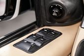 Close-up Of The Side Door Buttons: Window Adjustment Buttons, Door Lock. Modern Car Interior: Parts, poster