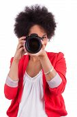 stock photo of afro hair  - Young african american photographer with camera isolated on white background - JPG
