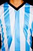 Man wearing an Argentinean shirt with stripes