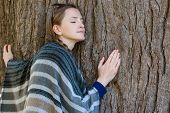 Young Woman Hugging The Trunk Of A Large Tree. Closed Eyes. Unity With Nature, Autumn Forest poster