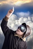 picture of bomber jacket  - Boy as an old style pilot holding a toy airplane - JPG