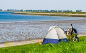 Tourist Camping In A Tent At The Beach Of Tholen, Touristic Location In Zeeland, The Netherlands poster