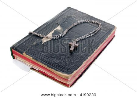 Silver Cross On Old Bible With Leather Cover